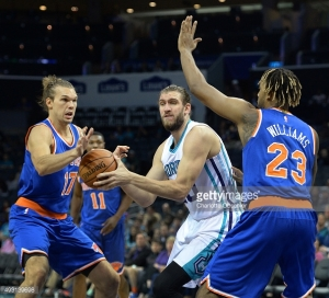 The Charlotte Hornets' Spencer Hawes, middle, fights to maintain control of the ball in the lane as the New York Knicks' Lou Amundson, left, and Derrick Williams, right, apply defensive pressure in preseason action on Saturday, Oct. 17, 2015, at Time Warner Cable Arena in Charlotte, N.C. (Jeff Siner/Charlotte Observer/TNS)